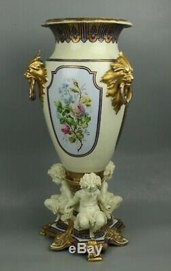 23 19C French hand painted porcelain Vase with Three Cherubs