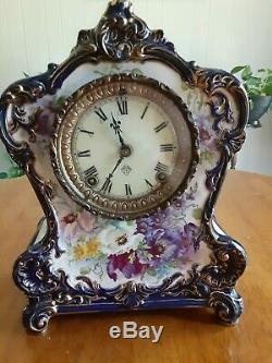 Ansonia porcelain clock by Royal Bonn, royal blue, hand painted great shape