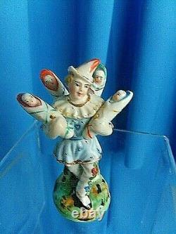 Antique Harlequin 1850 hand painted porcelain fertility figurine KINDERBRINGER