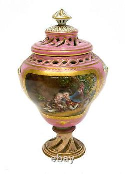 Sevres Hand Painted Porcelain Covered Urn, circa 1900. Courting scene
